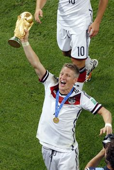 Final World Cup 2014 Brazil - Germany's Bastian Schweinsteiger holds up the trophy after winning the World Cup final soccer match between Germany and Argentina at the Maracana Stadium in Rio de Janeiro, Brazil, Sunday, July 13, 2014. Mario Goetze volleyed in the winning goal in extra time to give Germany its fourth World Cup title with a 1-0 victory over Argentina on Sunday.