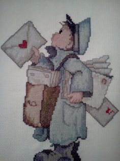 """Completed Hummel cross stitch of a Hummel cross stitch design """"The Postman"""" by nikkixstitch on Etsy  -  View 1 of 3"""
