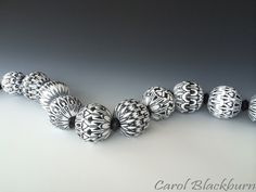 Large hollow beads each in a different pattern | Carol Blackburn Flickr