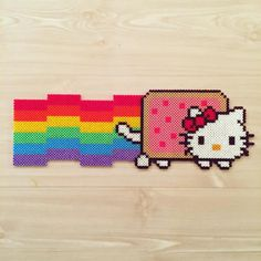 Get inspired by and make your own Hello Kitty pixel art from hama beads! 💖✨ Create your favorite characters as Hello Kitties, or just Hello Kitty herself! 🎀 Here has made a Nyan Cat Hello Kitty 🌈 So kawaii! Perler Bead Designs, Perler Bead Art, Fuse Bead Patterns, Perler Patterns, Beading Patterns, Perler Bead Ornaments Pattern, Beaded Ornaments, Fuse Beads, Pearler Beads