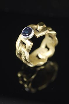 Large chain ring with dark blue topaz. The chain is brass and the stone is set in silver.Sizes 6.5 or 7All items are made to orderPlease allow up to 3 weeks for delivery.