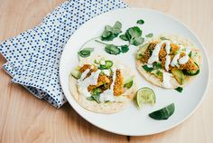 cornmeal crusted fish tacos with lime crema. * Use traditionally prepared tortillas made with lime-treated corn