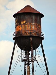 Don't really care for the words on the water tower :( Word On The Water, Dumpster Diving, Tank I, Roadside Attractions, Water Tank, City Streets, Train Station, Color Photography, Abandoned Places
