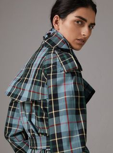 A trench coat by #Burberry in tartan cotton gabardine, woven for protection at the Burberry mill in Yorkshire. The relaxed cut has a pronounced storm shield and inverted box pleat at the back for volume.