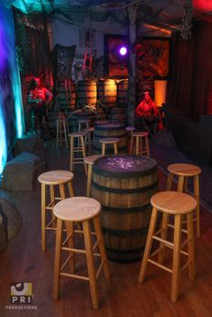 Pirate Room for Dream Day! Rum barrels as tables and pirate statues with awesome uplighting for added ambiance. Pirate Theme, Rustic Barn, Halloween Night, Event Planning, Bar Stools, Pirates, Barrels, Statues, Table