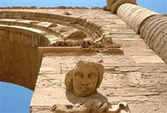 The face of a woman stares down at visitors in the Hatra ruins, 200 miles north of Baghdad, Iraq.