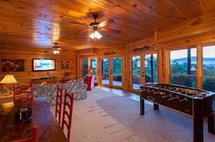 All Inspired Lodge | Cabin Rentals of Georgia - Enjoy a Game of Foosball Overlooking the Mountains