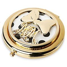 Minnie Mouse Signature Glass Compact Mirror | Disney Store You'll be seeing double with this Minnie Mouse Signature Glass Compact Mirror. The elegant gold metal case features Minnie's initials and trademark bow, and opens to reveal two glass mirrors, including a magnifying one for close-ups.