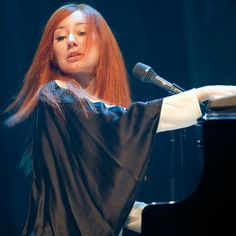Tori Amos. This picture reminds me of seeing her at the concert hall. Love her!!