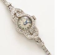 An art deco diamond and platinum bracelet wristwatch