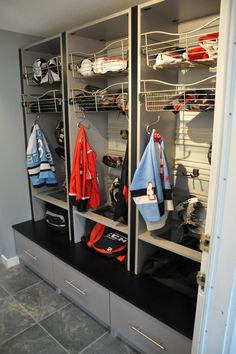 STORAGE CLOSET, AFTER: The closet was removed and custom-built lockers were installed to keep the kids' sports gear organized.