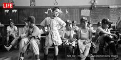 Little Leaguers (including their formidable leader, Dick Williams, center), await missing parts of their uniforms, Manchester, N.H., 1954.