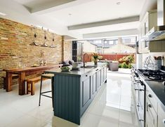 James and Kerry Lindsay extended into the loft and to the back of their property to create a characterful home full of original features Kitchen Diner Extension, Open Plan Kitchen, Kitchen On A Budget, Home Decor Kitchen, Kitchen Living, Kitchen Interior, New Kitchen, Home Kitchens, Brick Slips Kitchen