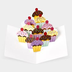 Perfect stocking stuffer for the cupcake-crazed!  6 Pop-Up Cupcake Note Cards by Robert Sabuda, $18.95