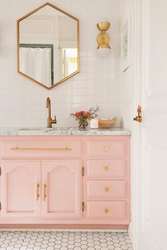 Patterned Wallpaper Bathroom With Marble Vanity And Gold