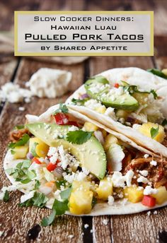 slow cooker hawaiian pulled pork tacos with pineapple salsa and cabbage slaw
