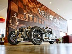 The V8 Hotel In Stuttgart, Germany - The V8 Hotel in Stuttgart is a car-lover's heaven, it´s a theme hotel with a design clearly inspired by the car world. The Hotel is located in an auto museum called Böblingen's Meilenwerk in Stuttgart, Germany. The hotel features themed rooms fit for both mechanics and car enthusiasts alike, it has four single rooms, 19 double rooms, tower suite and 10 theme-based rooms designed to impress visitors.