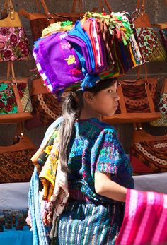 #Guatemala, young girl carrying her stuff on her head