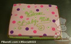 Social0223 | Baby Shower Cake | Light pink frosted cake with pink and purple polka dots and white daisies.