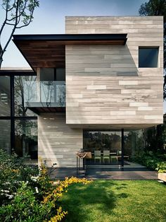 It seems lot of people are choosing this boxed up seventies look when building their houses and we love it!!! Try this washed timber look instead of dark stain, it gives this otherwise dark home a chic and modern look