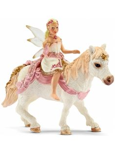 #Schleich Delicate Lily Elf Riding a Pony - The gentle elves like to set off early in the morning to ride towards the sunrise. The meadows are then still moist with dew and a delicate veil of mist often rests on all the greenery. available at #rollercoasterkids.com.au