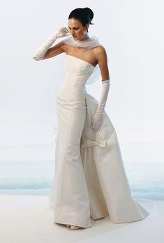 Brides: Le Spose Di Gio. Strapless mikado silk dress, with mermaid skirt, and rich train.