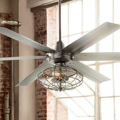 An industrial-inspired ceiling fan with included vintage style cage light kit.
