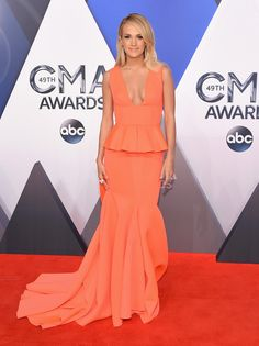 Carrie Underwood in Gauri & Nainika attends the 49th annual CMA Awards. #bestdressed