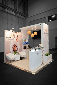 Nice looking, simple, professional exhibition stand. The addition of hanging lights is great.