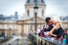 Couple cuddling on the Love Locks bridge in Paris (Pont des Arts)
