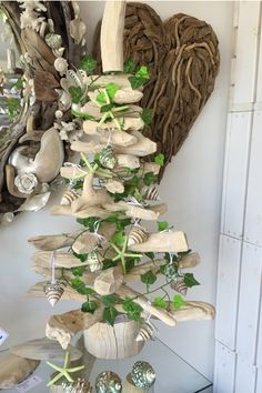 3ft Bleached Driftwood Tree decorated with green shells and foliage www.dorisbrixham.com