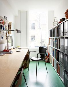 Radford and Crolla work from home in their studio off the lounge. They chose the green lino floor because it was cheap and colourful (try Jaymart for similar). The Pol chair is by Jorge Pensi for Akaba.