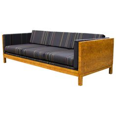 Milo Baughman Burl Case Sofa with Paul Smith Upholstery | From a unique collection of antique and modern sofas at https://www.1stdibs.com/furniture/seating/sofas/
