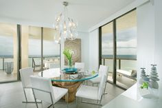 Dining Room:Captivating White Beach Themed Dining Room Ideas With Round Glass Dining Table With Green Floral Vases And Modern White Dining Chairs And Above Laminate Flooring Also Hanging Glass Pendant Lamp Lighting W 20 Beach Themed Dining Room Design