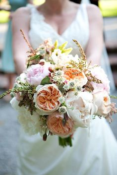 brides bouquet--These flowers are very pretty; also I like the tightness of this bouquet with a few things springing out