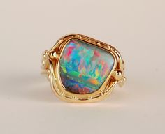 18k and 22k yellow gold ring with boulder opal