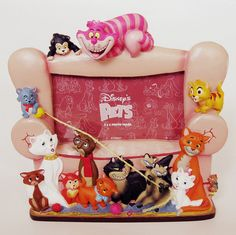 Disney cats frame- Not sure if I'd love this or it would really freak me out......