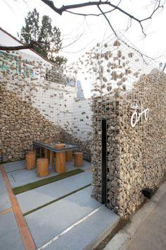 restaurant exterior Deconstructing the gabion wall. Cafe Ato by Design BONO, Seoul store design Landscape Architecture, Landscape Design, Architecture Design, Garden Design, Creative Landscape, Landscape Plans, Café Exterior, Design Exterior, Restaurant Exterior