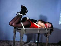 """putmeinherplace:  Technicolor hogtie. As I already noted, I love these kind of """"fixed"""" hogties. A simple sturdy table is perfect for that purpose."""