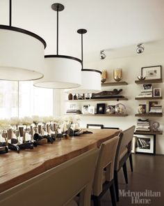 love the centerpiece and round light fixtures in this great modern dining room