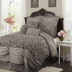 "Ruffled comforter set in gray with hand-sewn detailing.   Product: Queen: 1 Comforter, 1 bedskirt and 2 standard shamsKing: 1 Comforter, 1 bedskirt and 2 king shams Construction Material: PolyesterColor: GrayFeatures:  Hand-sewn detailing14.5"" Bedskirt drop  Dimensions: Standard sham: 20"" x 26"" eachKing sham: 20"" x 36"" eachQueen comforter: 92"" x 96""King comforter: 96"" x 110""Note: Accent pillows not included. Shams do not include inserts.Cleaning and Care: Dry clean"