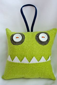 I SO wish I would have done a pillow for my kiddoes. So much easier than fishing for that tooth under the pillow!  Boy Tooth Fairy Pillow - Little Pet Monster - Ready to Ship - Green. $14.75, via Etsy.