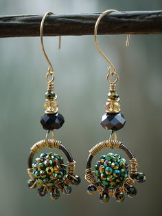 Peacock, black & gold wirewrapped earrings by whoozqueen wire jewellery