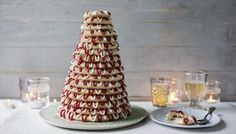 Kransekake is a Scandinavian cake that forms an impressive showpiece at celebrations including weddings and Christmas.  Equipment and preparation: for this recipe you will need six kransekake moulds (available from cookware specialists or online). Each mould comprises three rings, giving 18 rings in total.