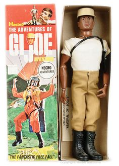 """12"""" vinyl Negro Adventurer action figure, from the Adventures of G.I. Joe series of toys, United States, 1969, by Hasbro. Although shown wearing the basic casual fatigues outfit associated with this figure, many of the black Adventurer GI Joe dolls are found in box wearing the French Resistance fashion with sweater and beret, a variation thought to originate from product sold by the Sears department store."""