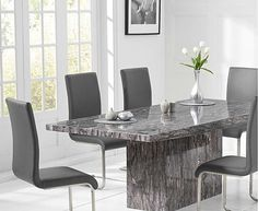 The Crema Grey Marble Dining Table with Malaga Chairs set seats 6 people. The marble dining table set features a grey marble dining table and PU leather dining chairs.