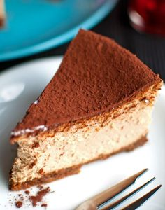 Tiramisu Cheesecake GF graham crumb crust 15g (or 1 tablespoon) melted butter 2½ tablespoons of Kahlua ¾ tablespoon Baileys 4 teaspoons of instant coffee powder 700g (or 1½ pounds) cream cheese, at room temperature 125g (or ¾ cup + 2 teaspoons) granulated sugar 3 whole eggs 1 egg yolk 100ml (or ⅓ cup + 4 teaspoons) whipping cream cocoa for dusting (optional) powdered sugar for dusting (optional