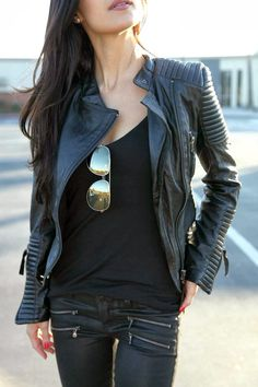Leather, jacket, jeans, and aviator shades. Love the zipper detailing on the jeans.