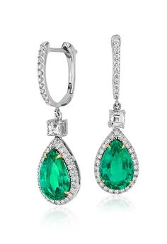 Graceful and sophisticated, these dramatic drop earrings feature stunning, vibrant emeralds set in 18k white and yellow gold.