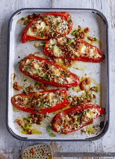 Romano rellenos with chipotle salsa. Stuffed peppers with a twist. These sweet Romano peppers are made to be filled with a spicy rice mix and mozzarella.